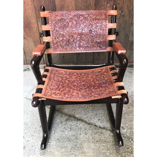 A vintage rosewood rocking chair by Mid Century artist Angel Pazmino , handcrafted , pegged together without nails and...