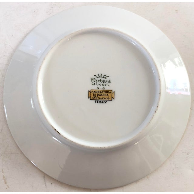 Pair of Richard Ginori butter plates banded in a deep orange and outside etched gold band. Makers mark on the back.