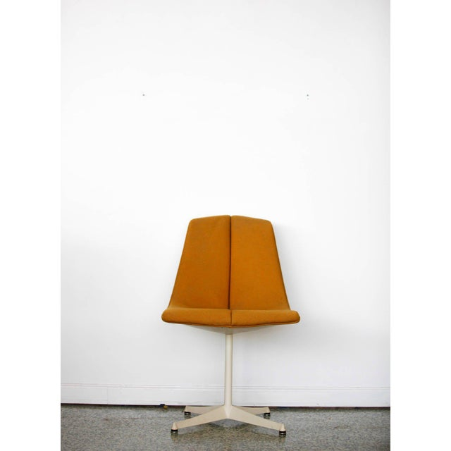 A chair designed by Richard Schultz for Knoll's Art Metal series in 1960s. Original orange tweed upholstery with a four...
