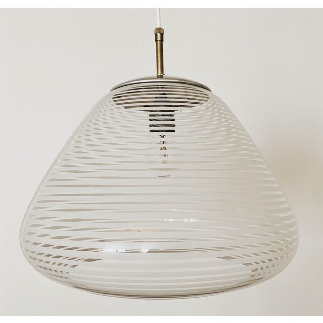Extraordinarily beautiful pendant lamp from the 50s. Very fine and beautiful design that fits beautifully in every room....