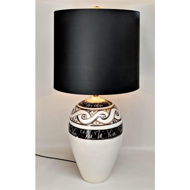 Large ceramic Lamp in cream with various hues of brown design. Shows beautifully! Measurements: Top of Socket: 22.5 in Top...