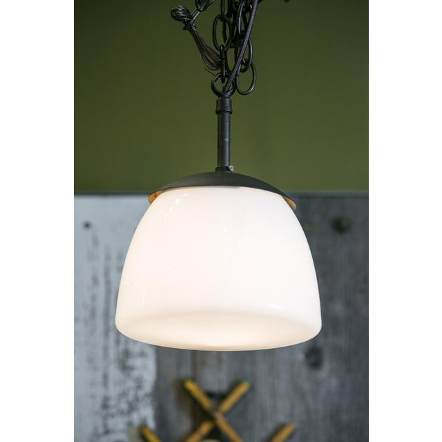 Antique milk glass and iron pendant circa 1930-1950. The French pendant is charming due to its smaller-than-usual size and...