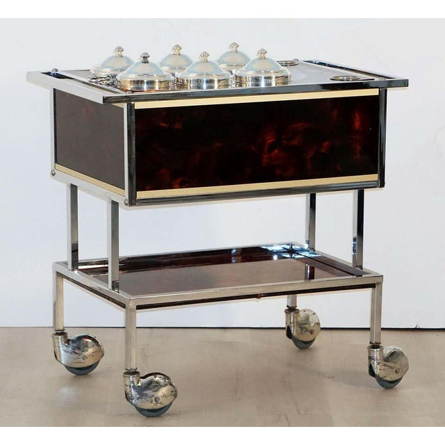 A fine Italian ice cream cart of chrome and faux tortoise shell, featuring a rectangular body with handle and six...