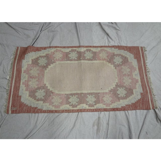 "This is a Swedish, Mid-century, hand-woven, flat-weave rug with the initials ""OA"" in the corner. The colors are mostly..."