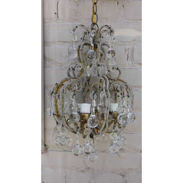Petite French crystal beaded three-light chandelier with clear drops. Newly rewired and in working condition. Includes...
