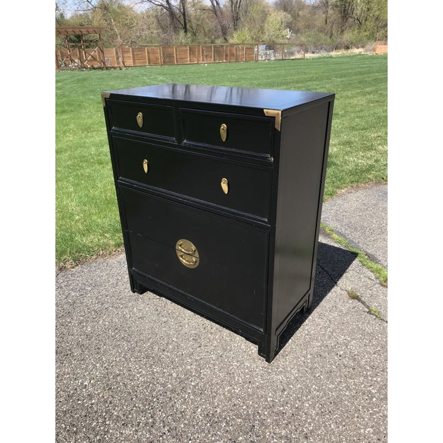 Ebonized black finish giving this Art Deco piece a semi chinoiserie vibe. Made by Kent Coffey. Two large bottom drawers....