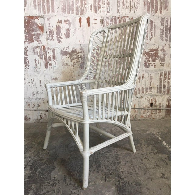 Set of four Ficks Reed high back chairs in white rattan. Definite statement pieces for any decor, indoor or out. Excellent...