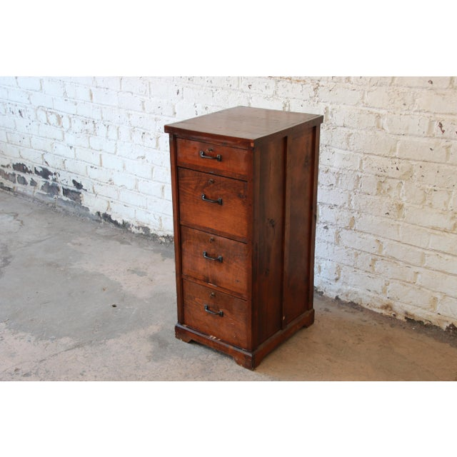 Offering a very nice pine Antique filing cabinet. The cabinet has a smaller  drawer at - Antique Pine 4-Drawer Locking File Cabinet Chairish