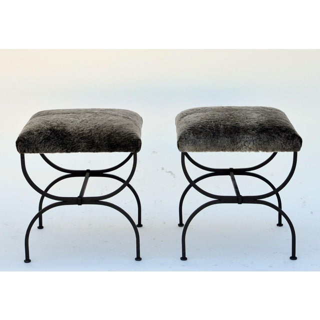 Pair of 'Strapontin' wrought iron and fur stools. Also available in C. O. M. (1 yard for both stools) or C. O. L. (2 × 4...