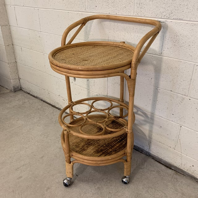 This is great little bamboo bar cart. Very sturdy. Two tiers and the bottom tier has bottle slots. The bamboo is in great...