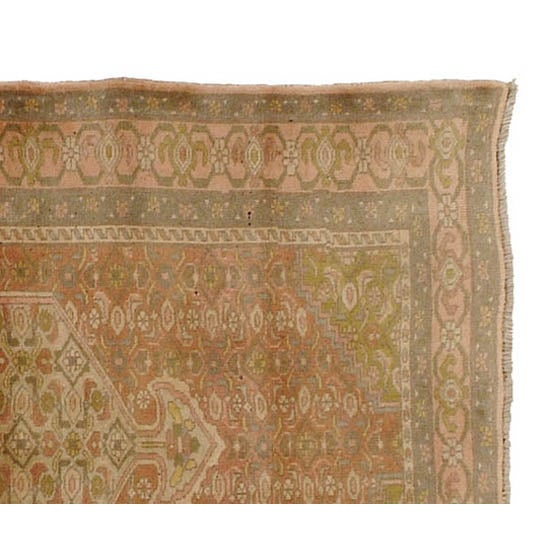 A vintage hand-knotted Persian Rug in excellent condition featuring muted earth tone coloring. Beautiful weave and design...