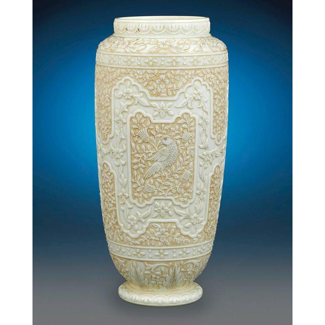 Exquisitely handcrafted to mimic the subtle luxury of ivory, these cameo glass vases by Thomas Webb & Sons are a...