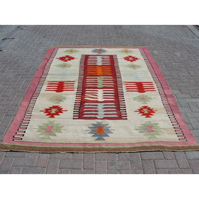 Vintage handwoven Turkish kilim rug. The kilim is nearly 40 years old. It is handmade, of very fine quality natural wool...