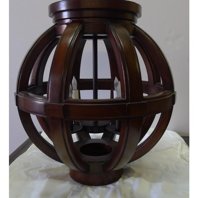 Paul Marra Carved Wood Sphere shown in dark walnut. Last one in this scale in stock. Oil rubbed bronze metal finish...