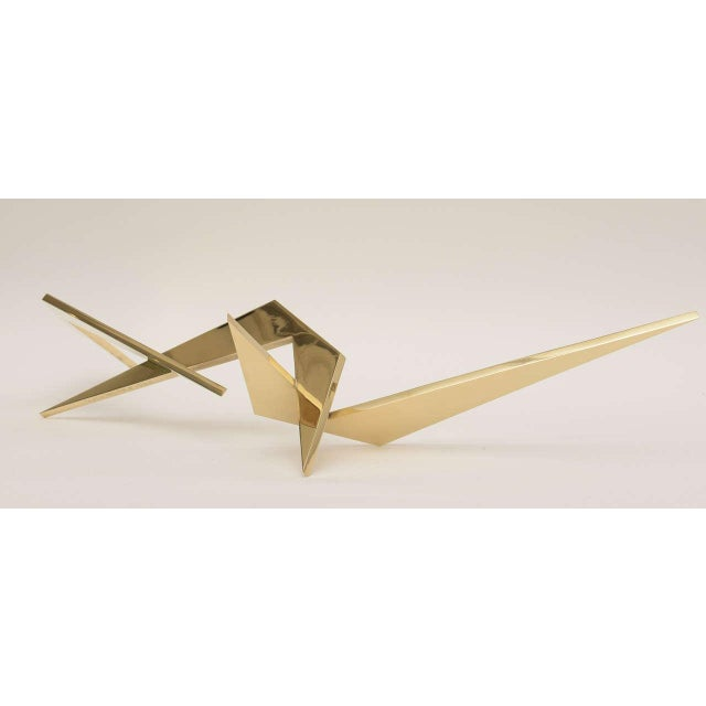 Connected angles, connected points make up this elongated bronze tabletop sculpture signed Larry Mohr. This is abstract in...