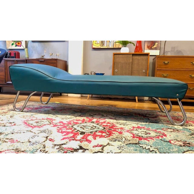 Classic Art Deco Design. 1930s Daybed/Chaise Lounge designed by KEM Weber. Turquoise vinyl with black trim. Tubular chrome...