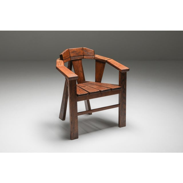 Unique craftsman chair in Walnut, Europe, 1960s. The abstract legs are in contrast with the wooden build up of the chair...