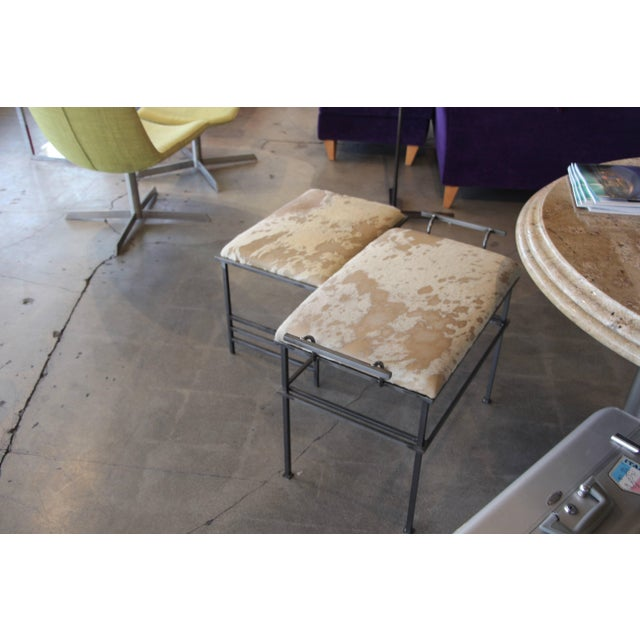 A matched pair of benches with Debrided Italian hides. These are probably handmade pieces, from viewing the from the weld...