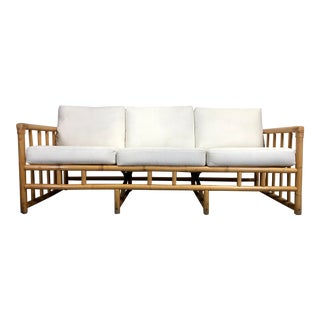 Vintage Ficks Reed Sofa With Side Table and White Upholstery For Sale