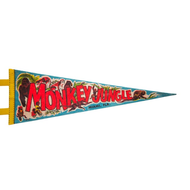 :: Fun and colorful vintage souvenir felt flag pennant from Monkey Jungle Island in Miami FL featuring imagery of gorillas...