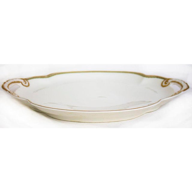 Stunning Limoges porcelain handled tray from Theodore Haviland made in France. Pure white with gold trim surrounding the...