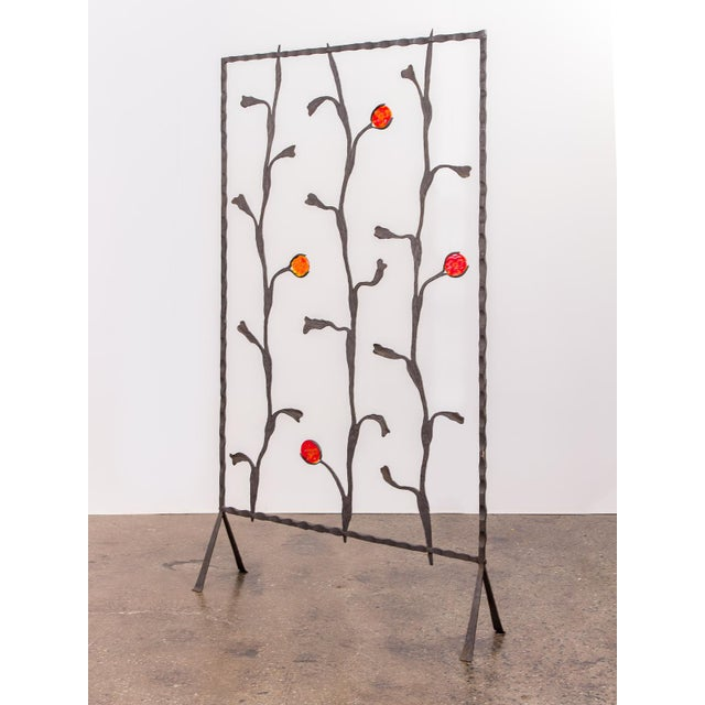 Brilliant and uniquely constructed, artisan free-standing wrought iron screen. Acquired from the original owner, this...