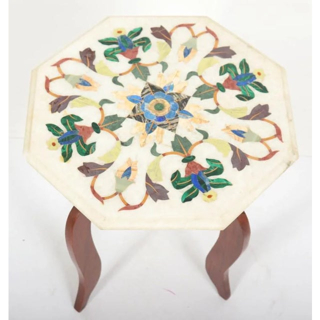 Octagonal hand-carved marble table with Italian Pietre Dure inlay floral mosaic, using semiprecious stones.