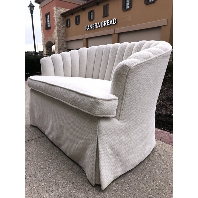 This vintage Art Deco 1940's channel back Settee has been beautifully restored in a white chenille with silver Lurex...