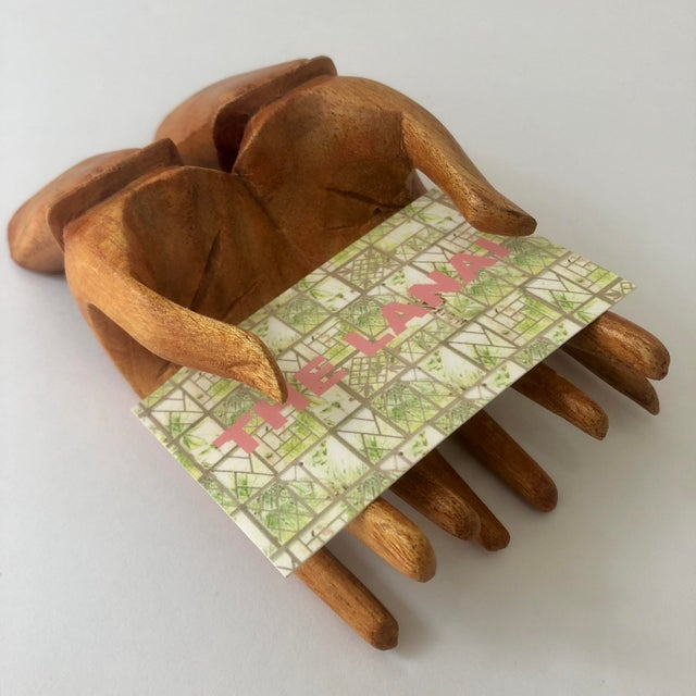Wooden hands card holder. Perfect for business cards, or to hold any small sign.