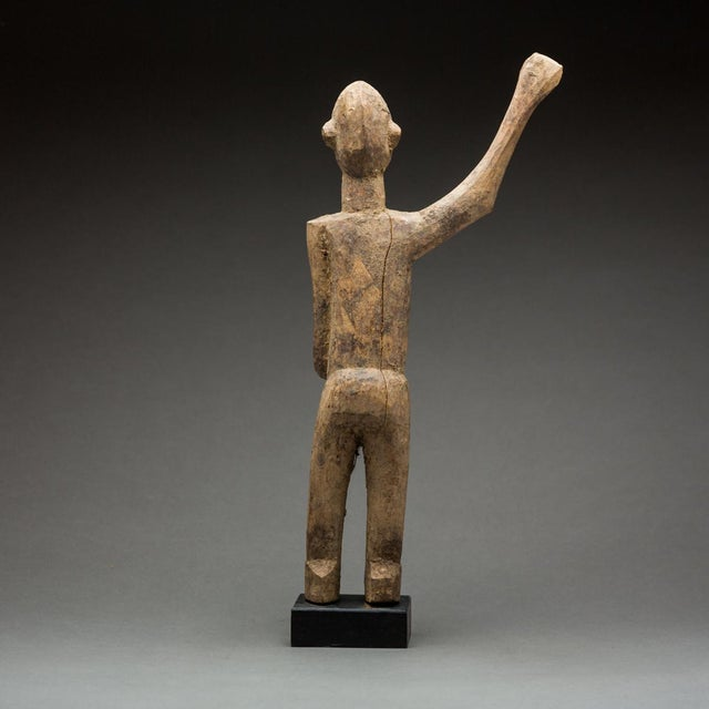 Lobi Sculpture of a Man With Upraised Arm For Sale - Image 4 of 5