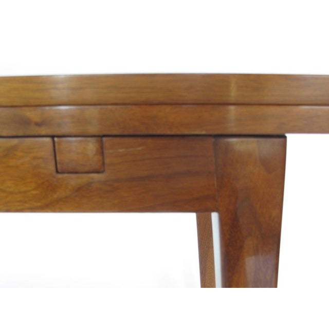 "A classic console table by Edward Wormley for Dunbar. Top extends from 17 to 34"". Practical yet simple solution. Note..."