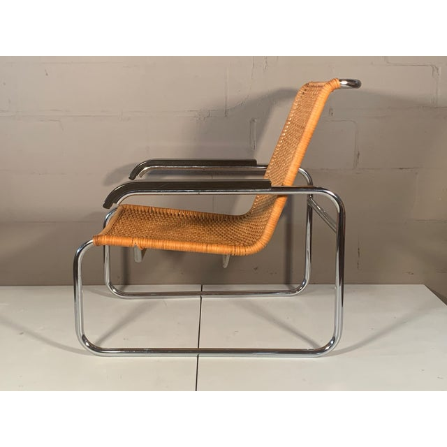 A beautiful pair of chrome and cane Marcel Breuer vintage arm chairs. Made in West Germany ca' 1970's and distributed by...
