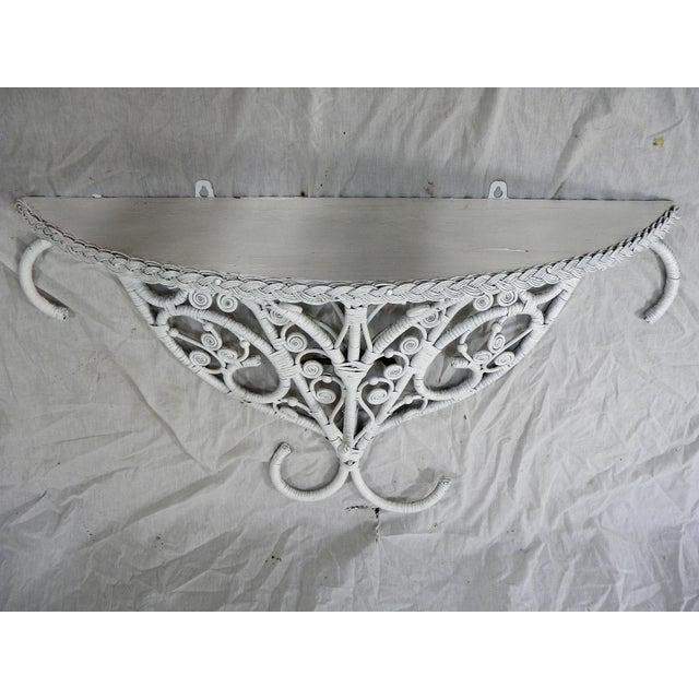 Lovely, vintage scroll work design console table. Hanging, demi-lune with wood top and open scrolled wicker bottom....