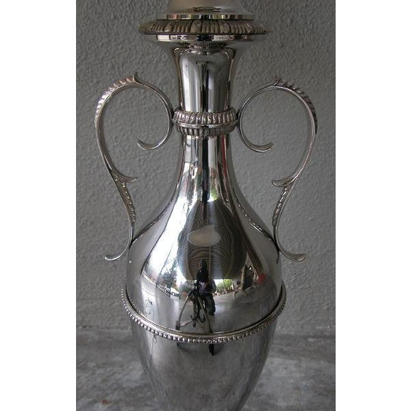 A sleek American art deco nickel-plated double-handled urn now mounted as a lamp; with slender flared neck flanked by...