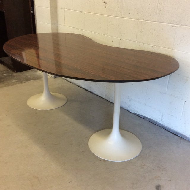 This is such a cool desk! Pure mid century with its laminate kidney shaped top and aluminum tulip shaped legs. Really...