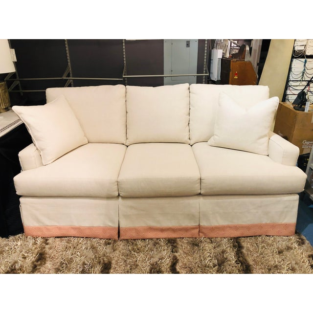 A fun and playful skirted sofa, with greek key tape banding, will make the perfect piece for any living room or great...