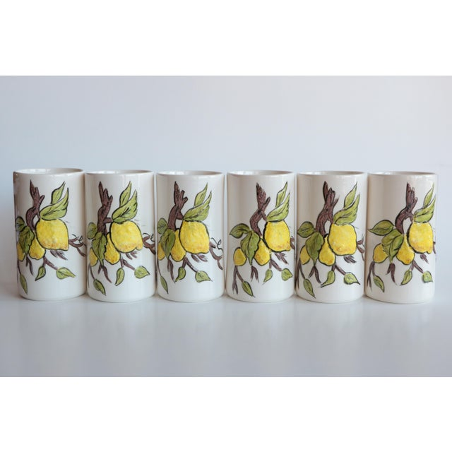 Vintage 1980 ceramic lemonade set with a heavily textured lemon branch motif. The tall streamlined pitcher has a glossy...