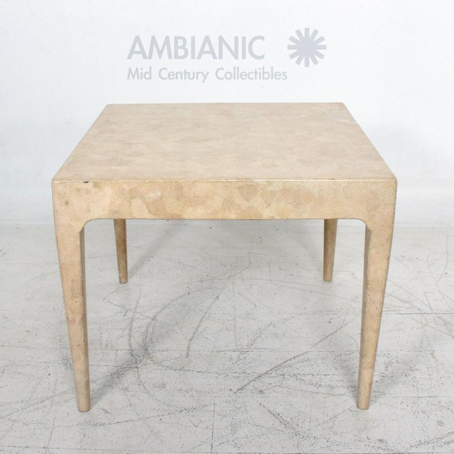 1970s exotic blonde wood occasional side table. The wood frame appears to be textured with wood covered in small shell...