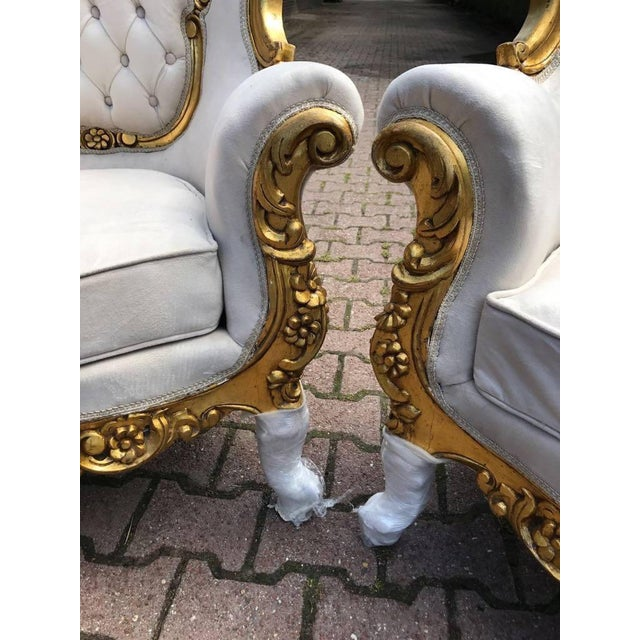 A set of two beautiful chairs in French Louis XVI style. The frame is recently re-done in gold leaf and they are recently...