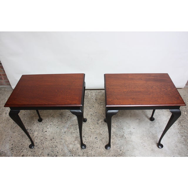 Pair of Chippendale style side tables (circa 1950s, USA) composed of ebonized walnut cabriole legs / knees with stained...