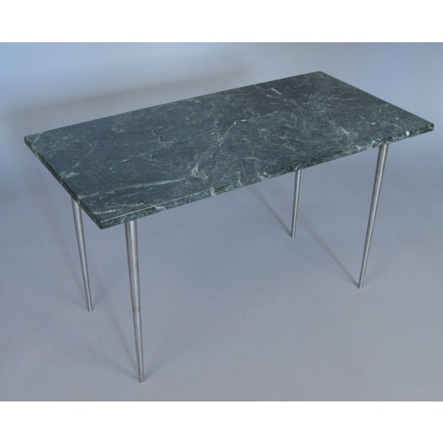 A very handsome vintage 1960s side table with brushed steel base with tapered tall legs and an Italian green marble-top....