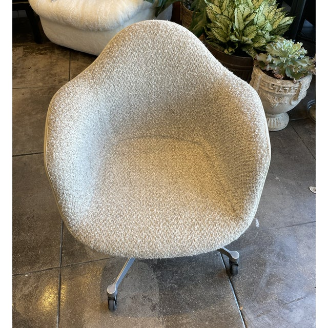 Vintage early Eames Task Arm chair with all original back and base reupholster in off-white boucle.