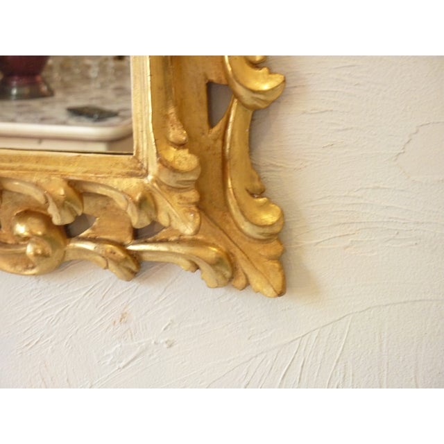 20th Century Italian skillfully carved giltwood rococo style frame with clear mirror, ready to hang vertically, change...