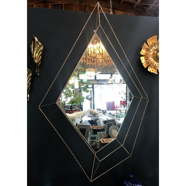 Italian large Rhomboidal sculptural wall mirror in brass. This mirror can also be mounted horizontally.