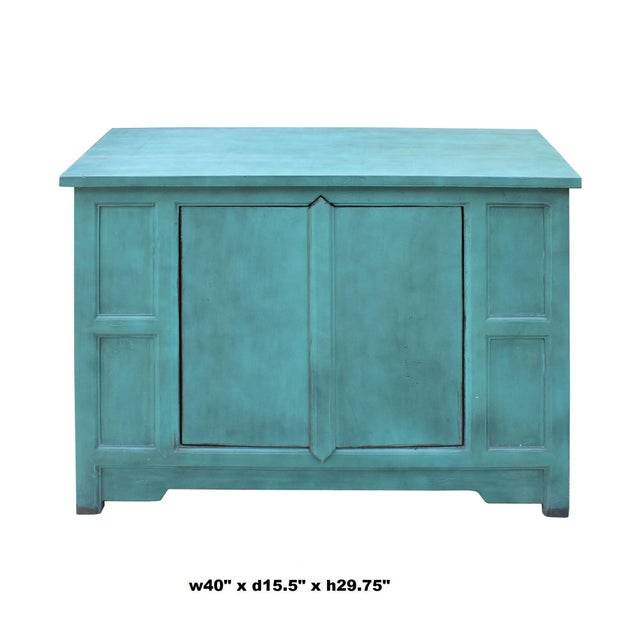 This is a solid wood cabinet , low credenza with plain clean two doors design. It is finished with a rustic light blue...