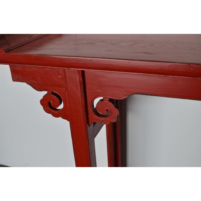 Simple in design, whimsical in color, and reasonable in cost. This beautiful red lacquer alter table with flared wings...