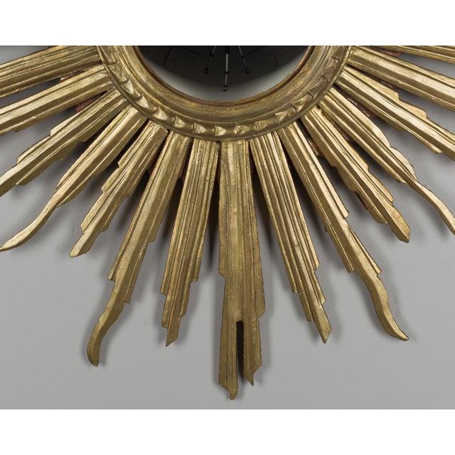 "An Italian gilded wood sunburst with convex mirror. Circa 1950-1960. 29"" Diameter"