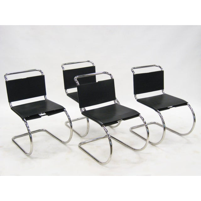 A set of 4 vintage MR chairs produced by Knoll in stainless steel. The sublime beauty of Mies' minimalist aesthetic is...