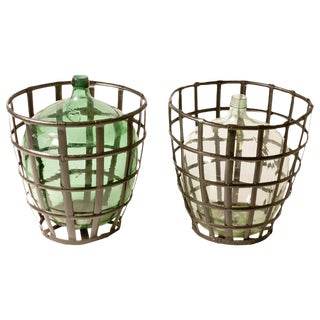 1900 French Metal Baskets With Bottles in Clear and Green Glass - A Pair For Sale