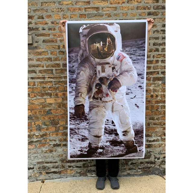 Large format reproduction print depicts U.S. astronaut Buzz Aldrin during the iconic 1969 Apollo 11 mission to land the...